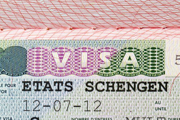 Schengen european visa stamp on passport