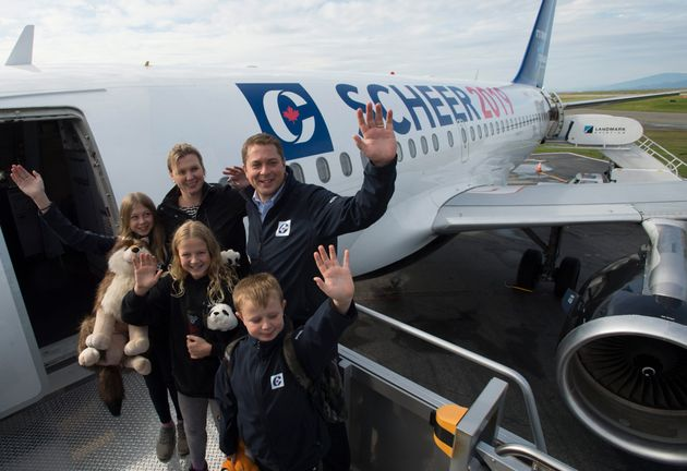 Andrew Scheer, his wife Jill, and kids Henry, Grace and Maddie wave as they board their campaign plane...