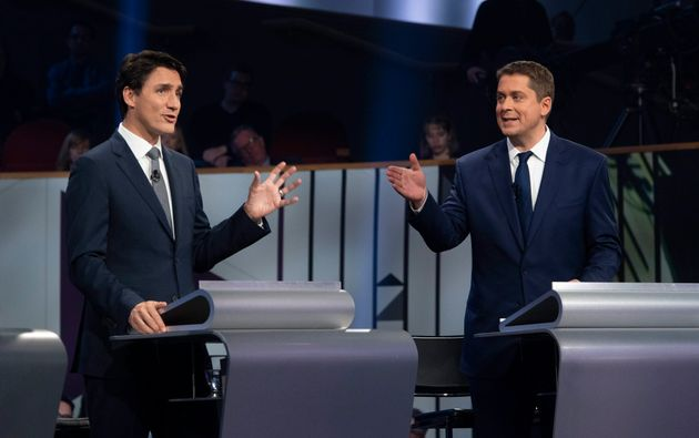 Justin Trudeau and Andrew Scheer take part in the federal leaders' French-language debate in Gatineau,...