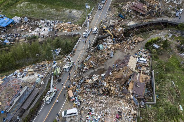 Buildings lie in ruins after they were hit by a tornado shortly before the arrival of Typhoon Hagibis,...