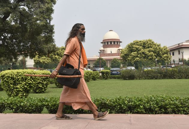 A sadhu arrives for the Ayodhya land dispute case hearing, at Supreme Court on September 16, 2019 in...