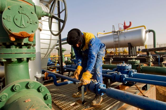 A worker is seen at the Zarzaitine gas field in In Amenas, 1,600 km (994 miles) southeast of Algiers...
