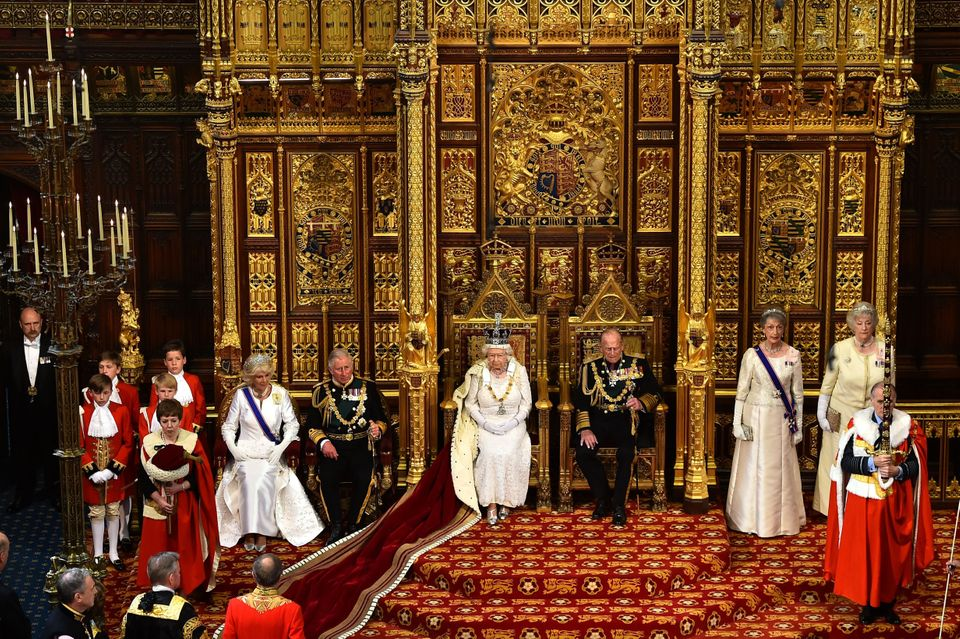 The Queen sat on the throne in the House of Lords next to Prince Philip, Prince Charles and the Duchess...