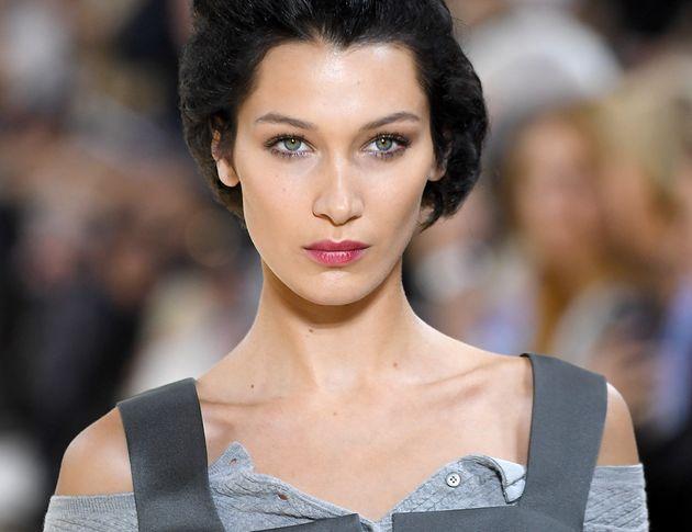 PARIS, FRANCE - OCTOBER 01: Bella Hadid walks the runway during the Miu Miu Womenswear Spring/Summer...