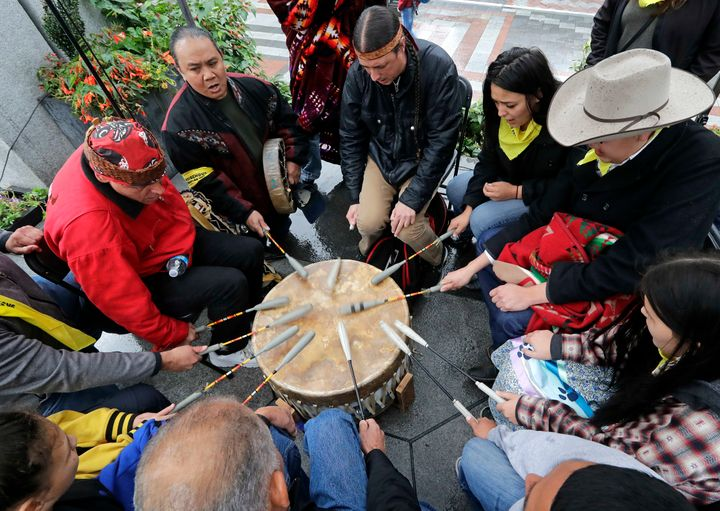 Native Americans and First Nations people join in on a drum circle during an Indigenous Peoples Day blessing and rally before