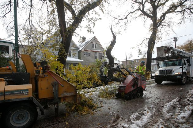 Crews clean up after a snow storm in