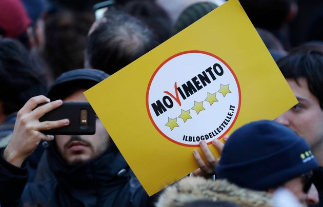 Supporters of Five-Star Movement (M5S) attend the party's final rally in Rome, Friday, March 2, 2018....