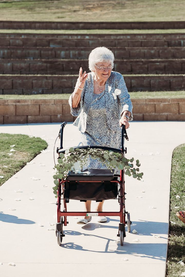 The bride's great-grandmother Kathleen Brown tossing some flower petals.