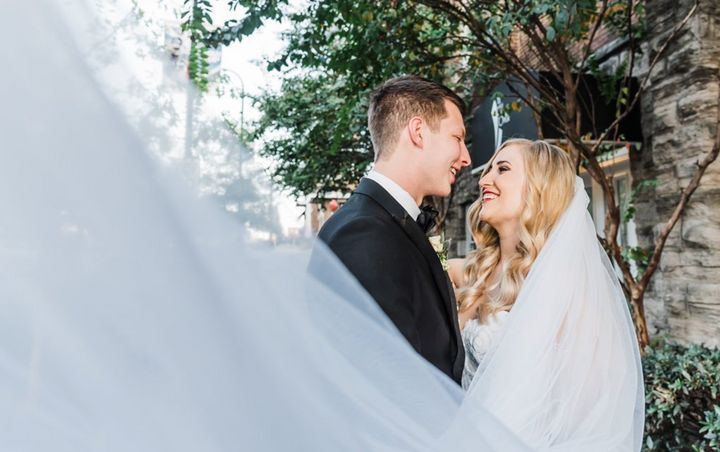 The happy bride and groom on their wedding day earlier this month.
