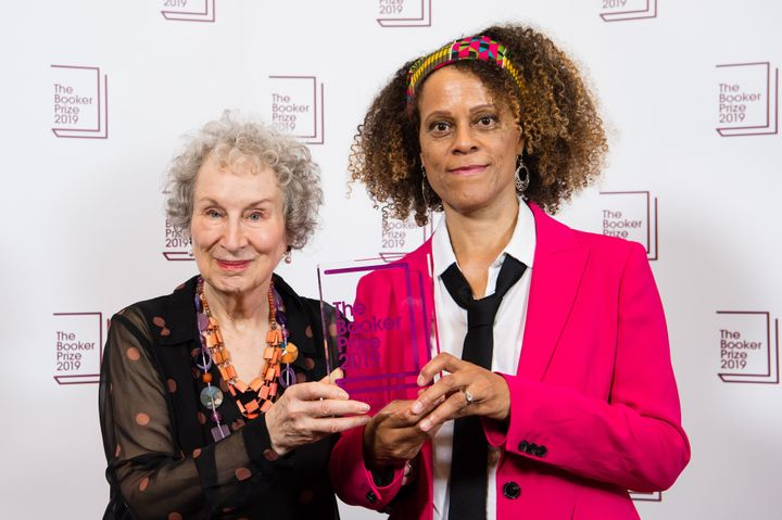 Joint winners Margaret Atwood, left, and c, right, pose with their 2019 Booker Prize Winner on Oct. 14, 2019, in London, England.