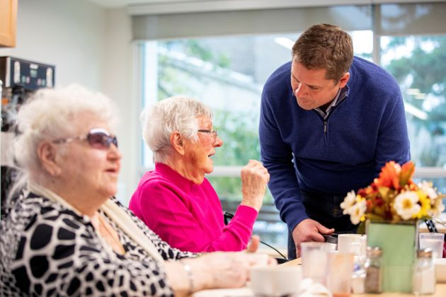 Andrew Scheer serves coffee while campaigning for the upcoming election at Donwood Manor, an assisted...