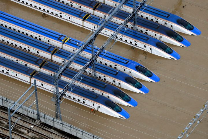 Bullet trains are seen submerged in muddy waters in Nagano, central Japan, after Typhoon Hagibis hit the city Sunday.