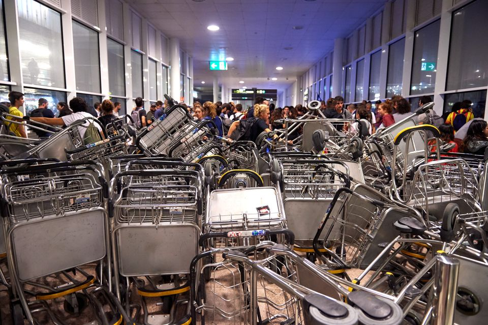 BARCELONA, SPAIN - OCTOBER 14: Barricades are seen at Barcelona Airport as people take part in a protest...