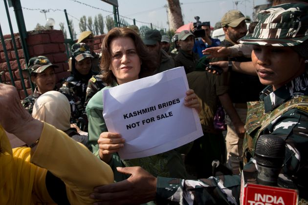Safiya Abdullah, daughter of Farooq Abdullah, holds a placard during a protest in Srinagar on October...