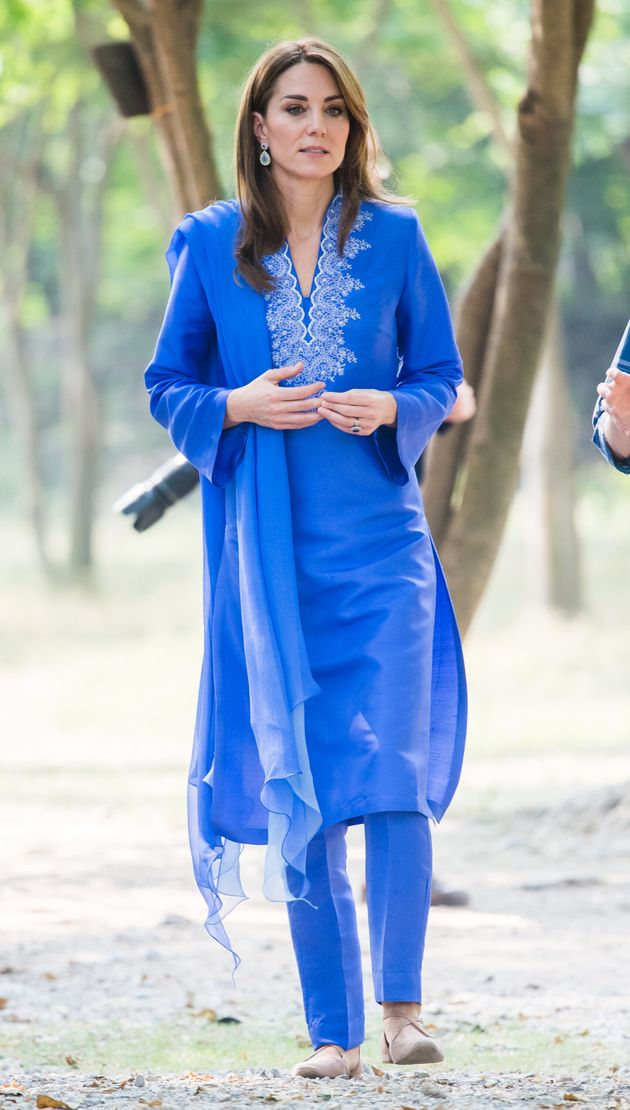 The duchess wears an embroidered blue shalwar kameez by Pakistani designer Maheen