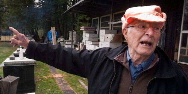Vladimir Katriuk points at his honeybee farm in Ormstown, Que., Wednesday, April 25, 2012. Katriuk, alleged...