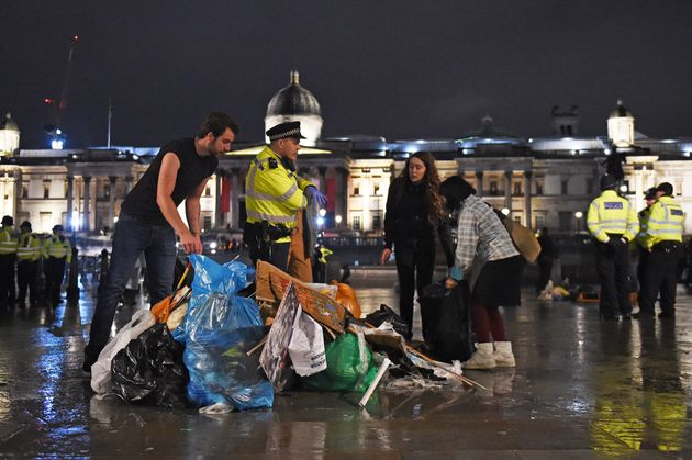 Protesters gather their belongings as police work to remove the last of the Extinction Rebellion demonstration...