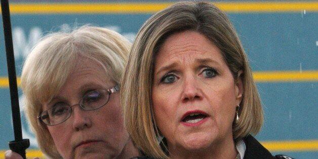NDP leader Andrea Horwath answers questions as candidate Peggy Sattler looks on in London, Ont., Tuesday,...