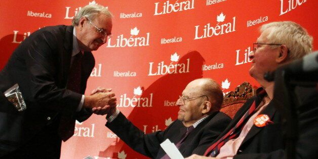 Former prime minister Paul Martin (left) shakes hands with former Liberal cabinet minister Herb Gray...