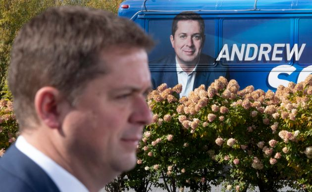 Conservative Leader Andrew Scheer makes an announcement near the campaign bus during a campaign stop...