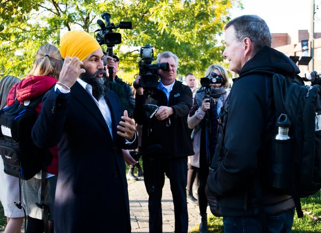 Jagmeet Singh answers question from voters in a park during a campaign stop in Toronto on Oct. 15,