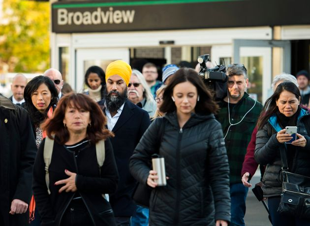 Singh walks with subway commuters during a campaign stop in Toronto on Oct. 15,