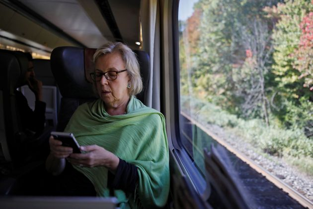 Elizabeth May travels by train for an election campaign visit in Montreal on Oct. 8,