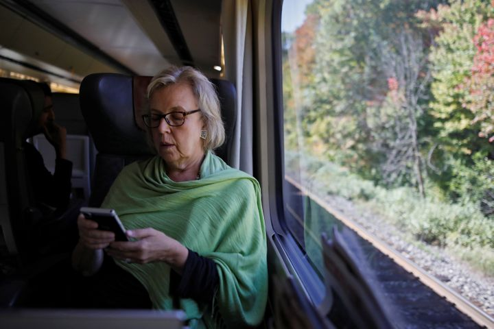 Elizabeth May travels by train for an election campaign visit in Montreal on Oct. 8, 2019.