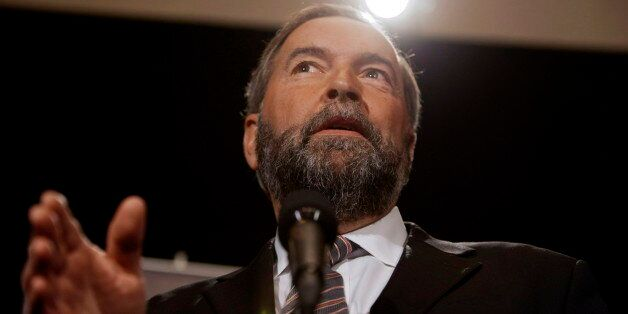 After saying he'd start attacking the Liberal record, NDP Leader Thomas Mulcair did just that Wednesday morning at his party's caucus retreat in Saskatoon, delivering a no holds barred speech painting the Grits and Tories as one and the same. (CP)