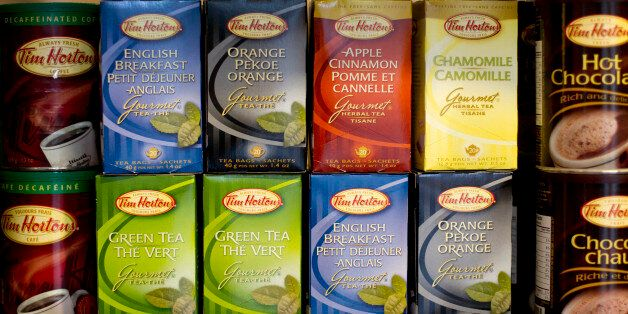 Various Tim Horton Inc. coffee and teas are displayed for sale at a restaurant in Toronto, Ontario, Canada. Photographer: Brent Lewin/Bloomberg via Getty Images