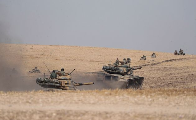 Turkish tanks and troops stationed near Syrian town of Manbij, Syria, Tuesday. Oct. 15, 2019. Russia...