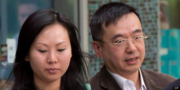 Franco Yui Kwan Orr and his partner Oi Ling Nicole Huen arrive at the B.C. Supreme court in downtown...