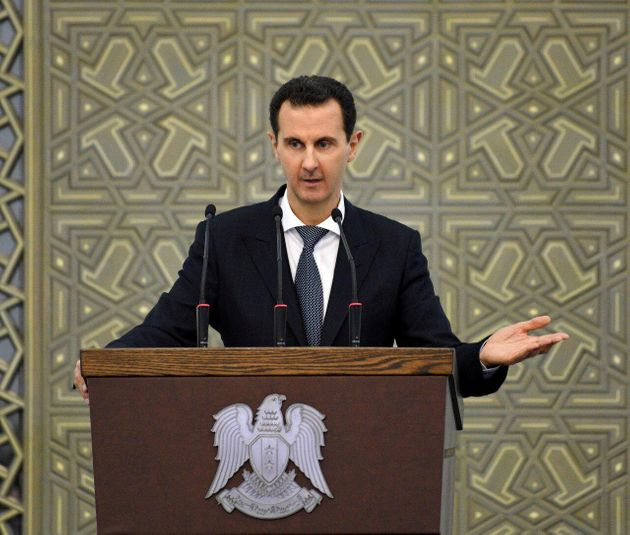 Syria's President Bashar al-Assad speaks during a meeting with heads of local councils, in Damascus,...