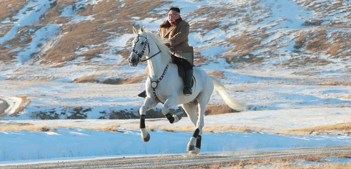 North Korean leader Kim Jong Un rides a horse during snowfall in Mount Paektu in this image released by North Korea's Korean