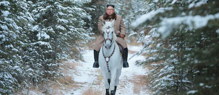 North Korean leader Kim Jong Un rides a horse during snowfall in Mount Paektu.