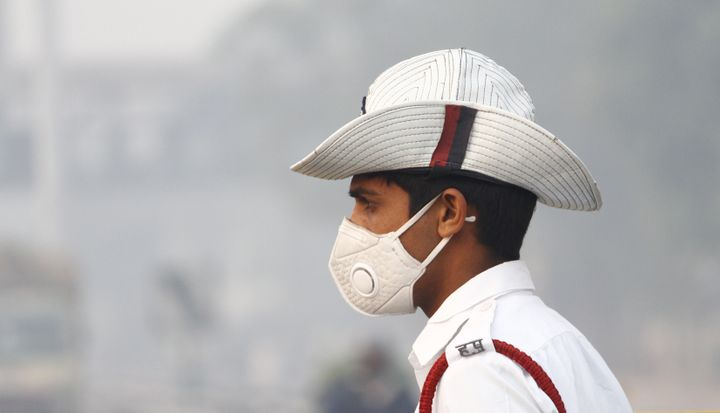 Traffic police personnel wear anti-air pollution masks amid heavy smog and air pollution, in November, 2018 in Gurugram.