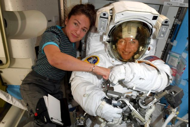 FILE - In this image released Friday, Oct. 4, 2019, by NASA, astronauts Christina Koch, right, and, Jessica...