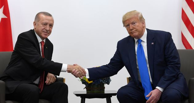 President Donald Trump, right, shakes hands with Turkish President Recep Tayyip Erdogan, left, during...