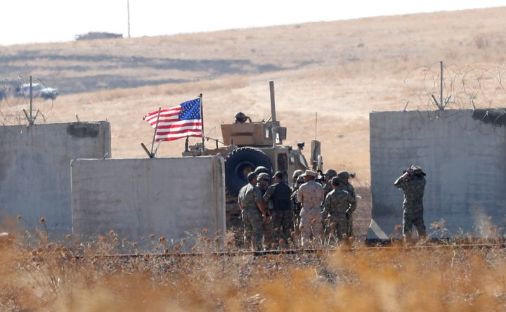 <strong>Turkish and US troops meet on the Turkish-Syrian border for a joint US-Turkey patrol in northern Syria last month.</strong>