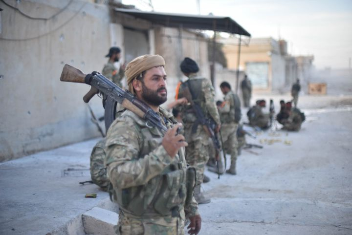 <strong>Syrian National Army (SNA) members have a rest as they launch an operation in Syria's Ras al-Ayn villages after the city center was cleared of PKK terrorists and the Syrian Kurdish YPG militia, which Turkey regards as a terror group.</strong>