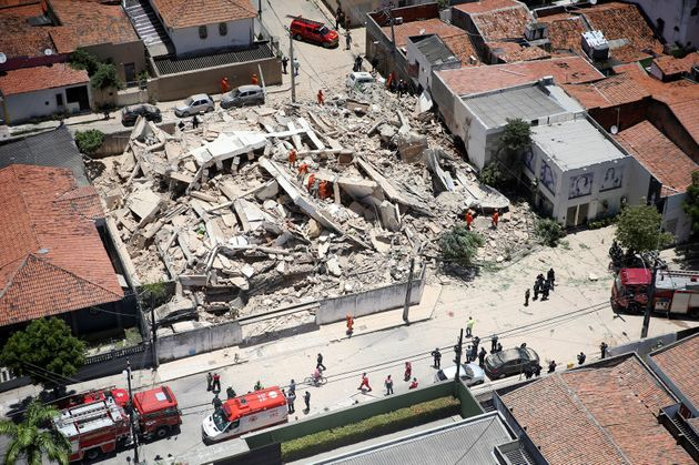 Firefighters search for survivors after a building collapsed in Fortaleza, Ceara state, Brazil, Tuesday,...