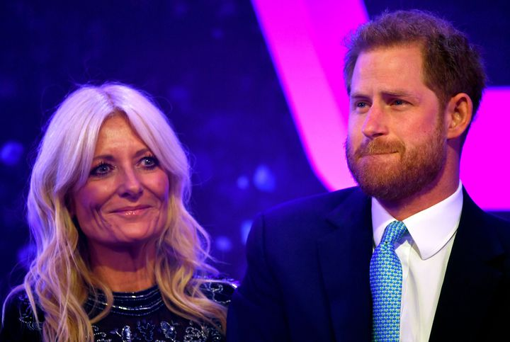 Prince Harry reacts next to television presenter Gaby Roslin as he delivers a speech during the WellChild Awards Ceremony reception in London on Oct. 15.
