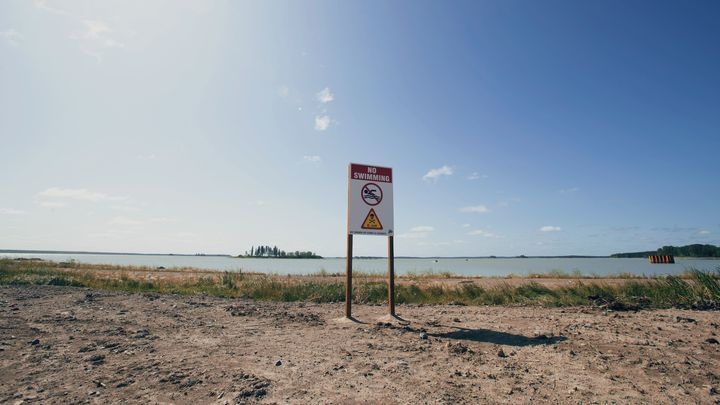 """A """"No Swimming"""" sign is shown on the Tataskweyak Cree Nation on Aug. 21, 2019."""