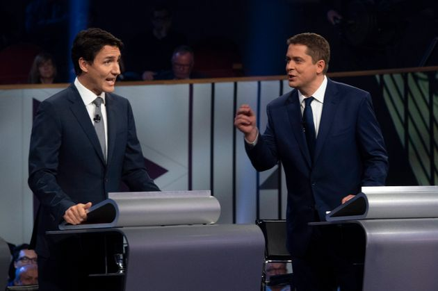 Justin Trudeau and Andrew Scheer take part in the the federal leaders' French-language debate in Gatineau,...
