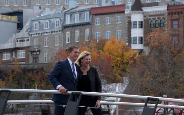 Conservative Leader Andrew Scheer and his wife Jill Scheer walk across a bridge following a campaign...