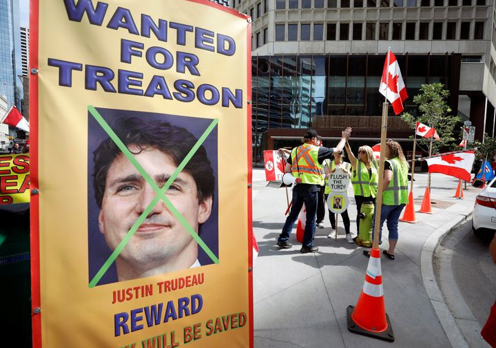 Protesters demonstrate outside a Liberal Party fundraiser where Canadian Prime Minister Justin Trudeau was speaking in Calgar