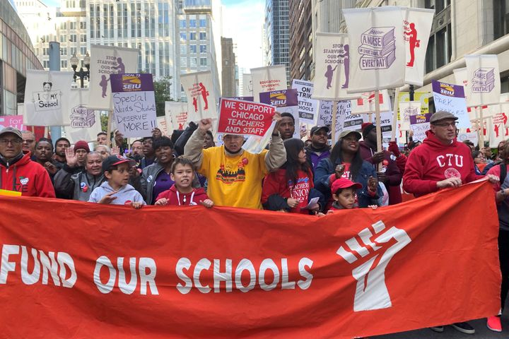 Hundreds of teachers and supporters march in Chicago on Monday, days before the teachers union was set to go on strike if a c