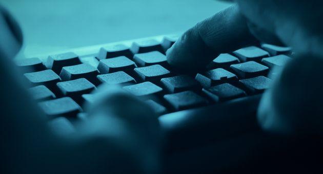 Hands typing on desktop pc computer