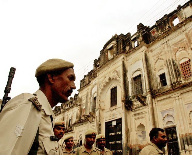 A policeman stands guard outside a temple in Ayodhya, July 6,
