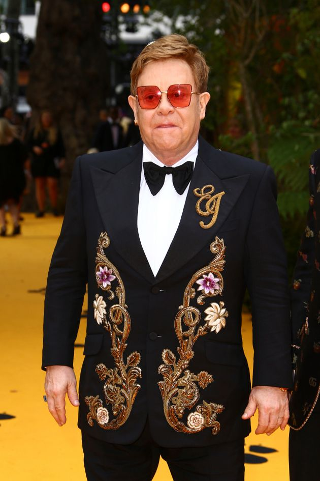 Singer Elton John poses for photographers upon arrival at the 'Lion King' European premiere in central...